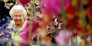 Britain's Queen Elizabeth smiles as views flower displays in the Great Pavillion at the RHS Chelsea Flower Show 2019, Monday May 20, 2019. .RHS / Luke MacGregor