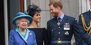 The Queen on the Buckingham Palace balcony with the Duke and Duchess of Sussex