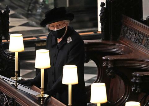 windsor, england   april 17 queen elizabeth ii watches as pallbearers carry the coffin of prince philip, duke of edinburgh into st george's chapel by the pallbearers during the funeral of prince philip, duke of edinburgh at windsor castle on april 17, 2021 in windsor, united kingdom prince philip of greece and denmark was born 10 june 1921, in greece he served in the british royal navy and fought in wwii he married the then princess elizabeth on 20 november 1947 and was created duke of edinburgh, earl of merioneth, and baron greenwich by king vi he served as prince consort to queen elizabeth ii until his death on april 9 2021, months short of his 100th birthday his funeral takes place today at windsor castle with only 30 guests invited due to coronavirus pandemic restrictions photo by yui mok wpa poolgetty images