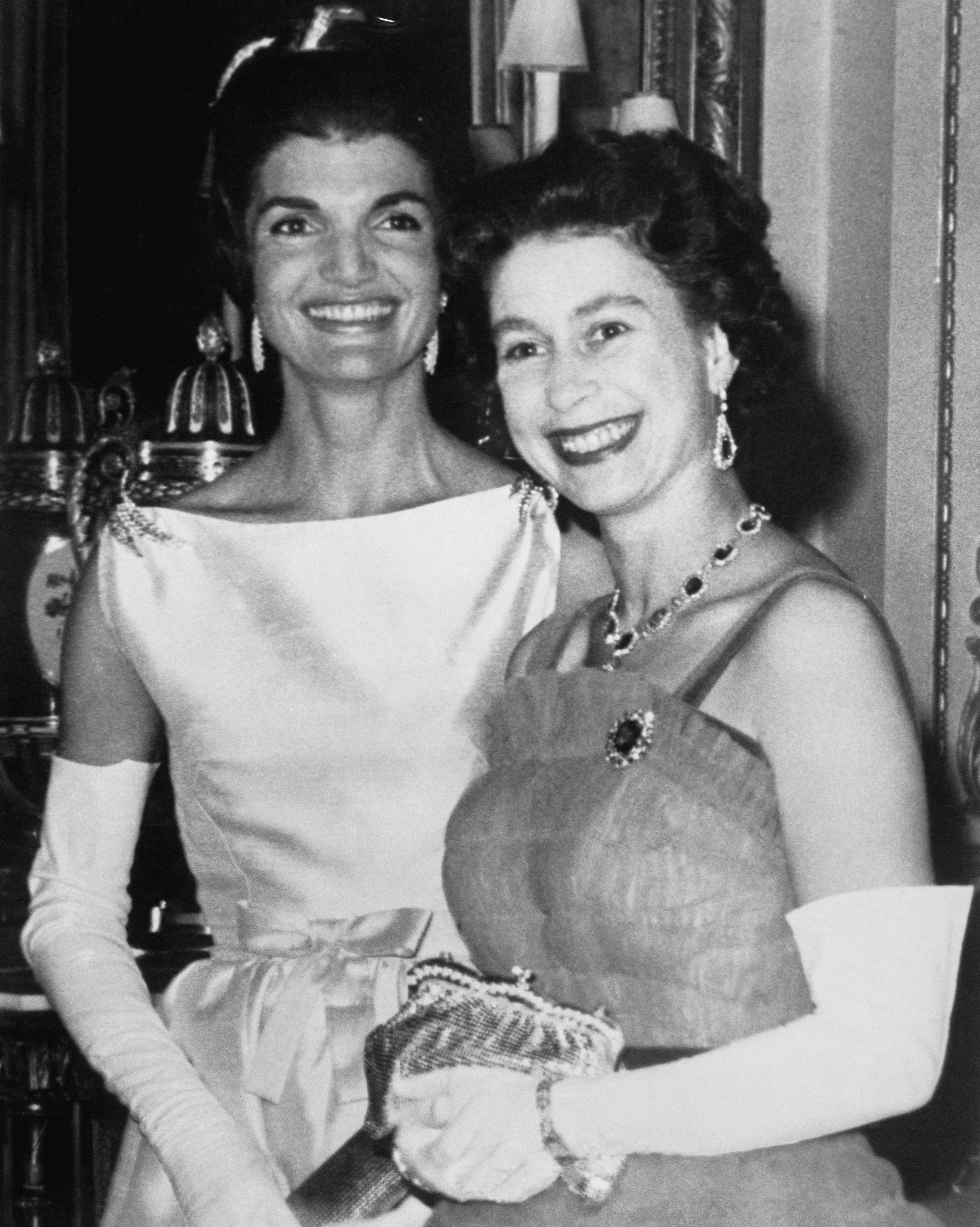 Jackie Kennedy and Queen Elizabeth pose for photos during an American state visit to Buckingham Palace. The event was the first time an American president dined at the Palace since 1918 and was even depicted on Season 2 of The Crown.