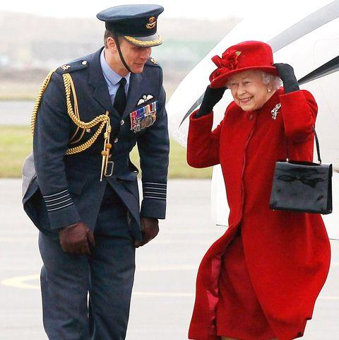 Red, Uniform, Gesture, Costume, Style, Military uniform,