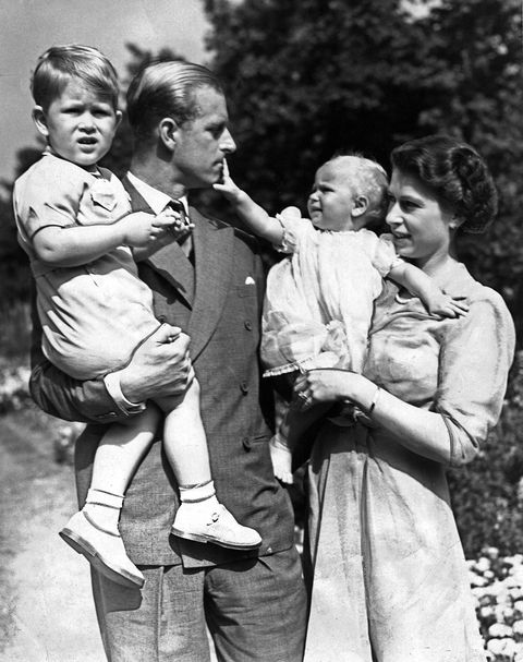 Queen Elizabeth II and her husband Prince Philip with their two children Prince Charles and Princess Anne. Circa 1951.