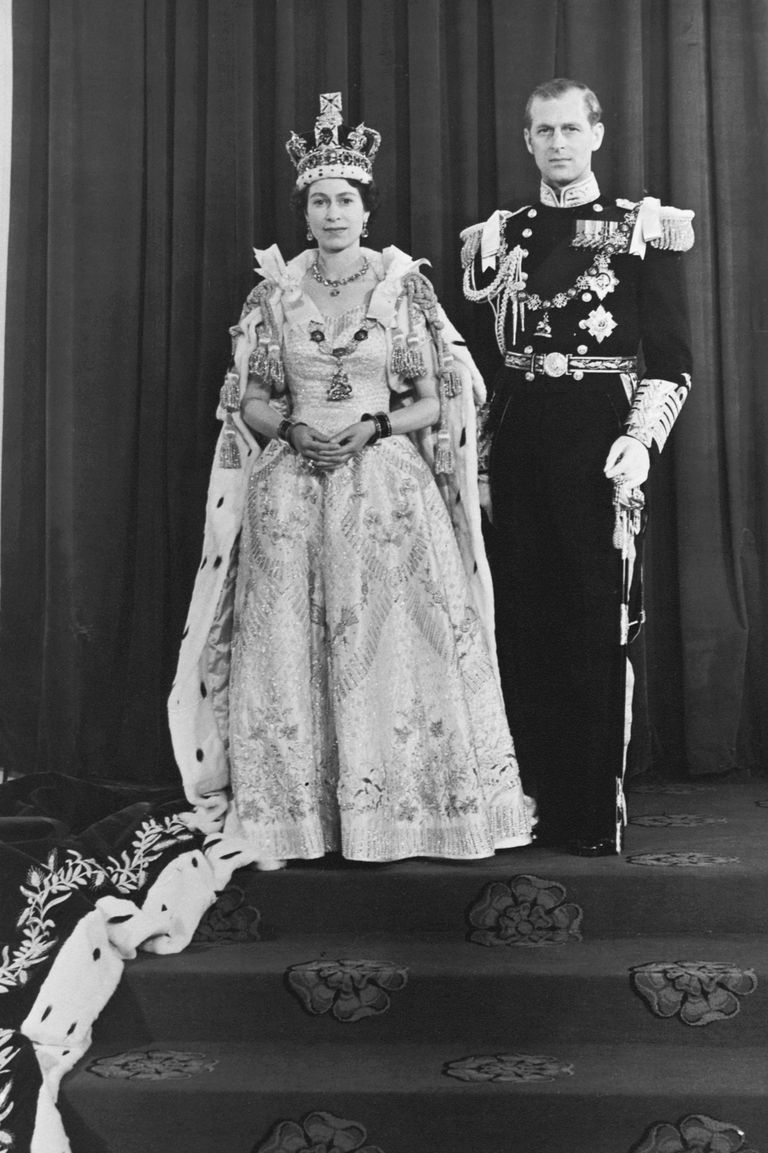 For her coronation day, the Queen had an elaborate gown designed by Norman Hartnell. The dress was made of a white duchess satin, and was embroidered with floral emblems representing the commonwealth countries in a gold and silver thread.