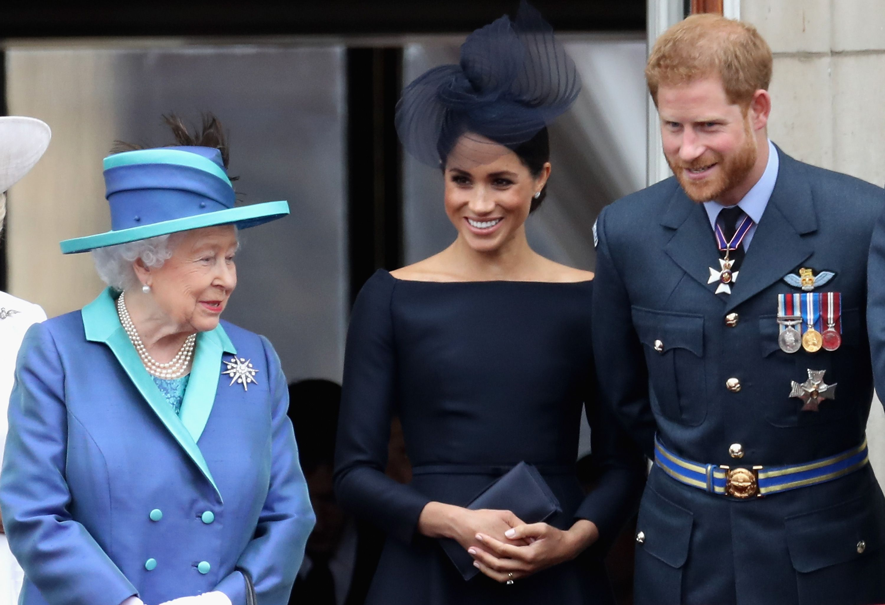 queen elizabeth says meghan markle and prince harry are much loved by royal family meghan markle and prince harry