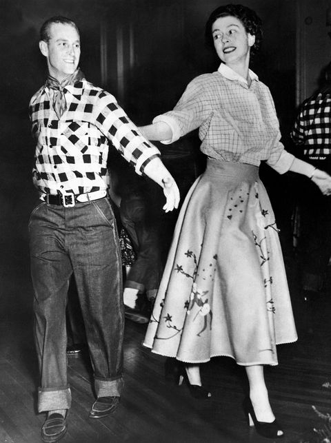 queen elizabeth ii, princess elizabeth and the duke of edinburgh square dancing at a cowboy dress party during the royal
