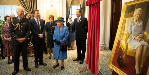The Queen Visits The Royal Air Force Club To Mark Its Centenary Year