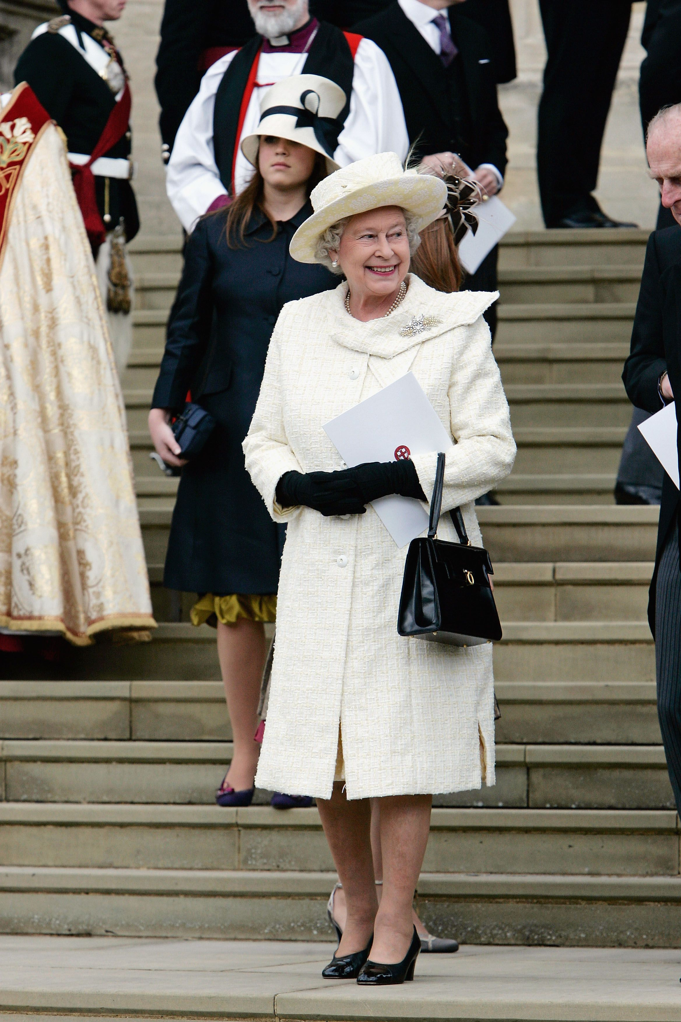Because both Prince Charles and his wife, Camilla Parker Bowles were divorced before they wed, the couple elected to have a civil marriage ceremony followed by a blessing at Windsor Castle instead of a traditional church service. Her Majesty attended the blessing in a cream-colored coatdress with subtle patterns of yellow.