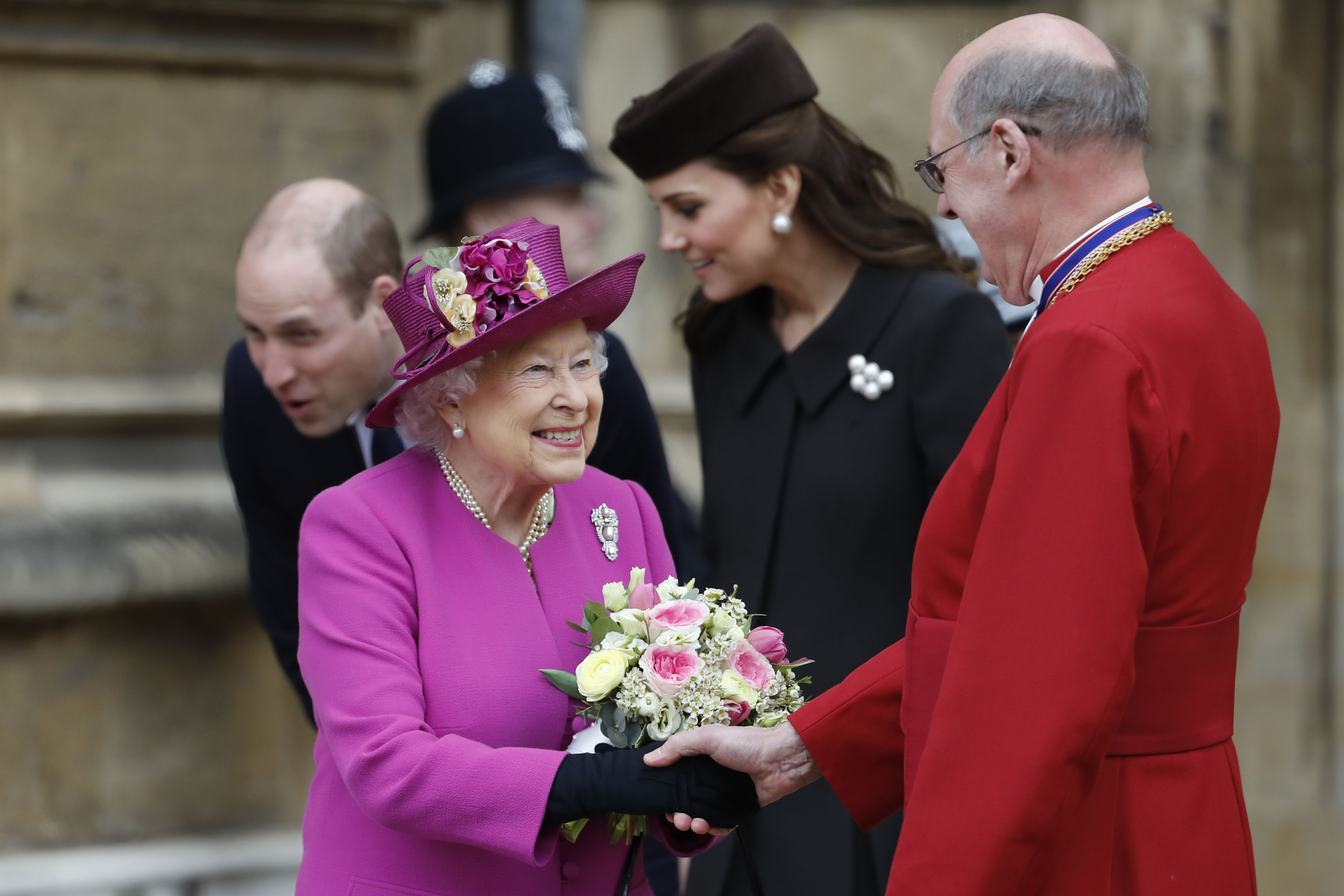 Queen Elizabeth II smiles as she shakes hands with Dean of Windsor, David Conner after attending the Easter Mattins Service at St. George's Chapel, Windsor Castle on April 1, 2018.