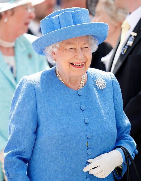 queen giggles with serviceman during video call