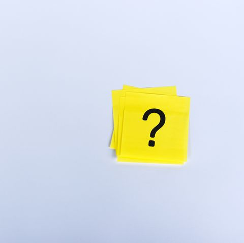 question marks on sticky yellow note