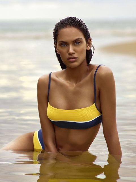 Clothing, Bikini, Skin, Beauty, Yellow, Swimwear, Photo shoot, Model, Undergarment, Summer,