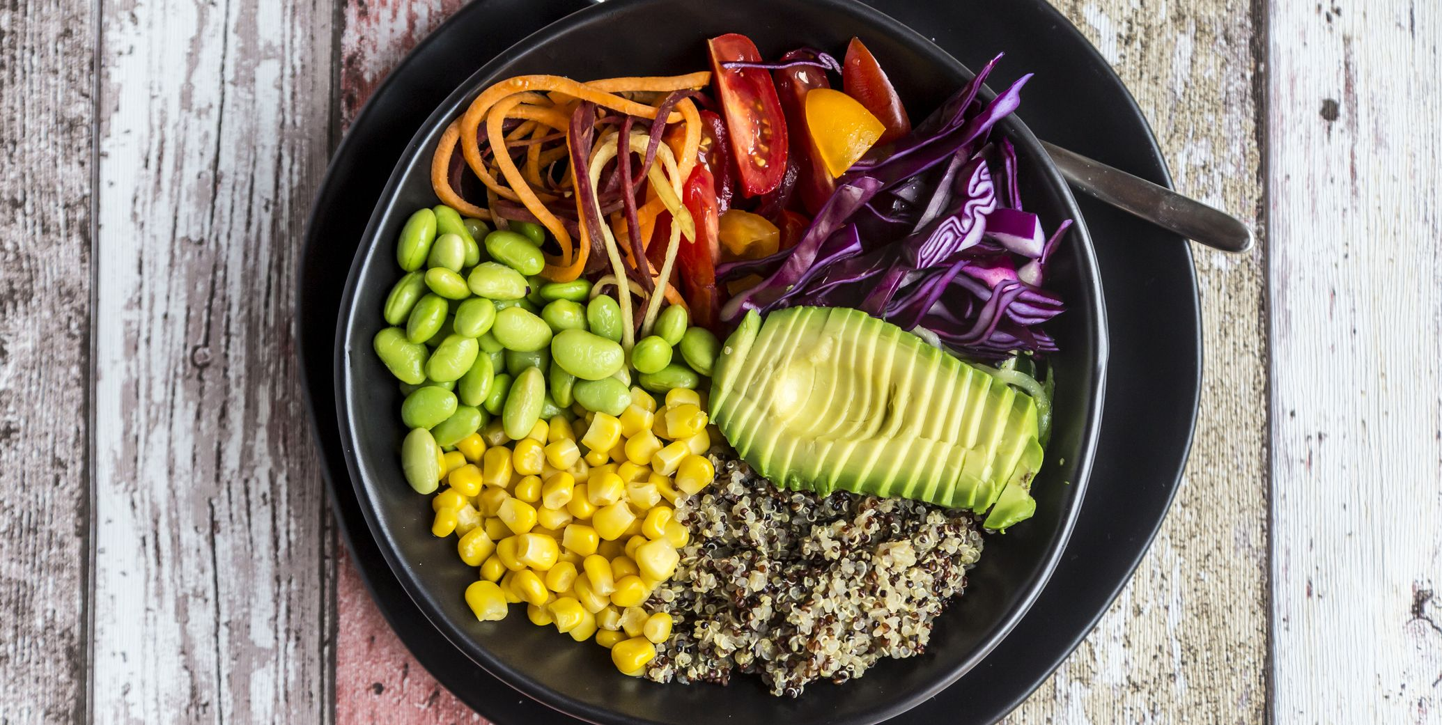 Quinoa veggie bowl of avocado, Edamame, tomatoes, corn, red cabbage and carrots
