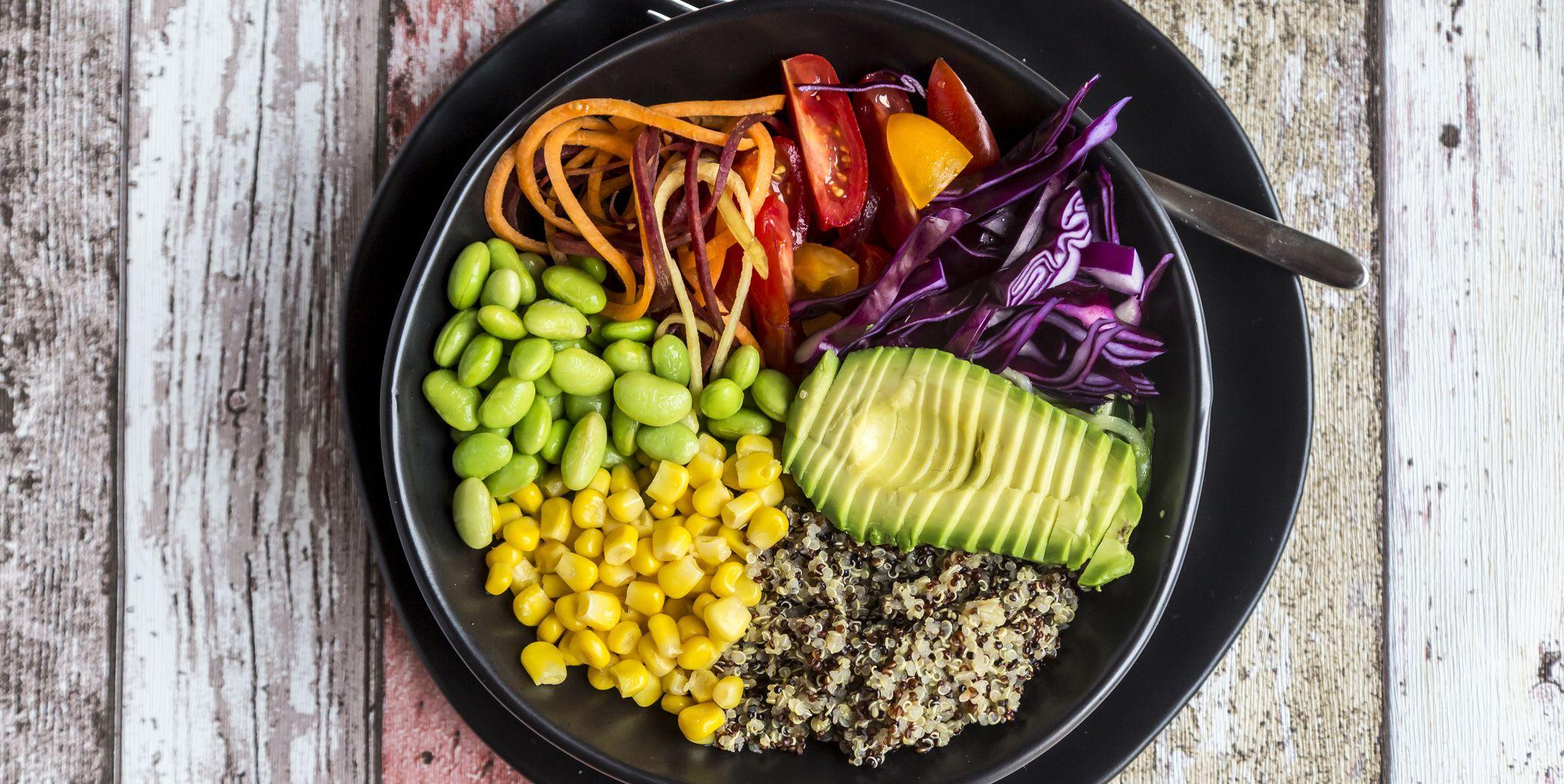 Quinoa veggie bowl of avocado, Edamame, tomatoes, corn, red cabbage and carrots