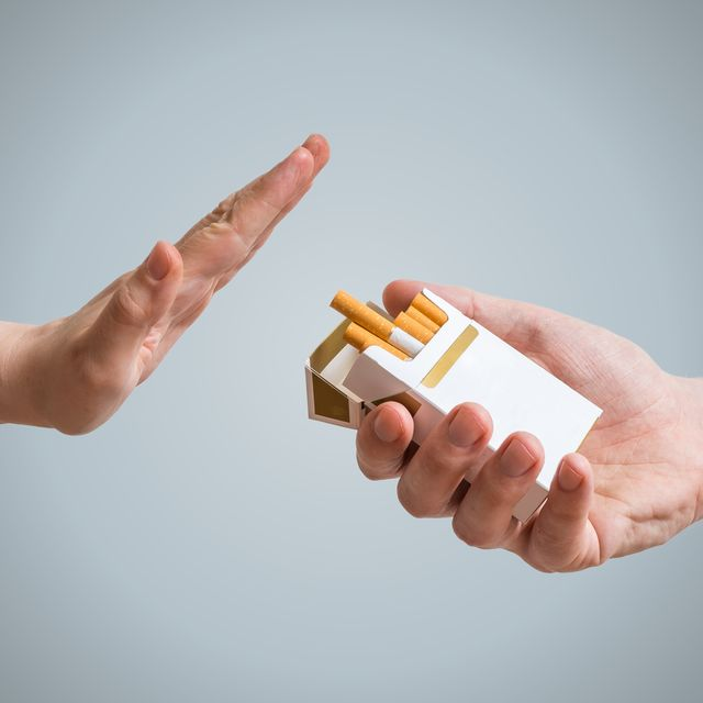quitting smoking concept hand is refusing cigarette offer