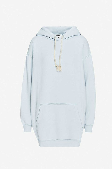 still life shot of powder blue acne studios longline hoodie from selfridges
