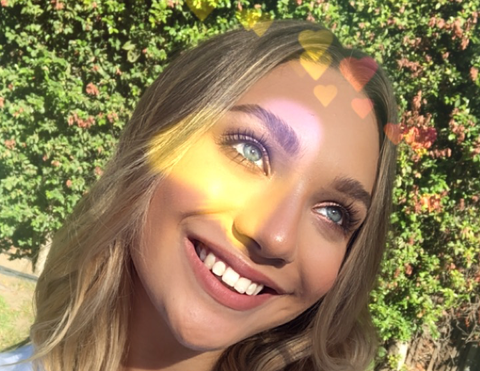 Hair, Facial expression, Blond, Lip, Beauty, Hairstyle, Smile, Yellow, Fun, Ball,