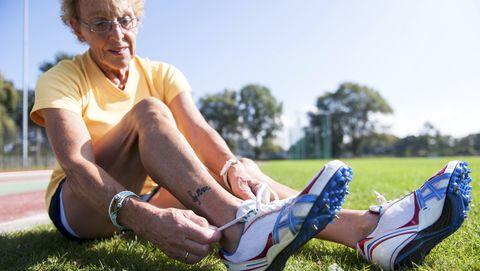 Grass, Footwear, Blue, Human leg, Sitting, Leg, Shoe, Ankle, Knee, Summer,