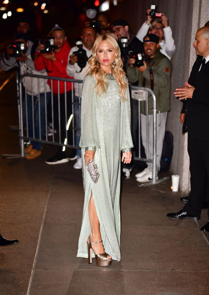 The fashion designer wore a shimmering tea green dress.