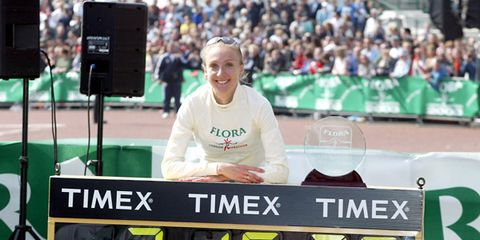 Paula Radcliffe poses with timing clock after her marathon world record