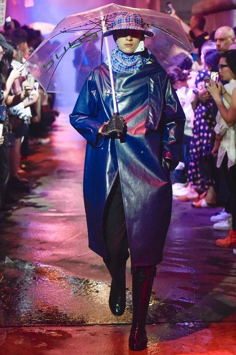 Fashion, Event, Fashion design, Haute couture, Electric blue, Headgear, Performance, Outerwear, Fashion show, Costume,