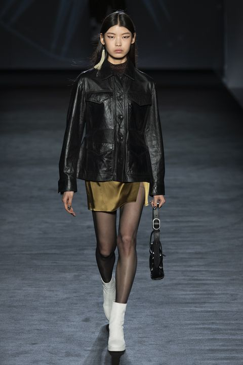 Fashion model, Fashion show, Fashion, Runway, Clothing, Shoulder, Leather, Knee, Footwear, Jacket,