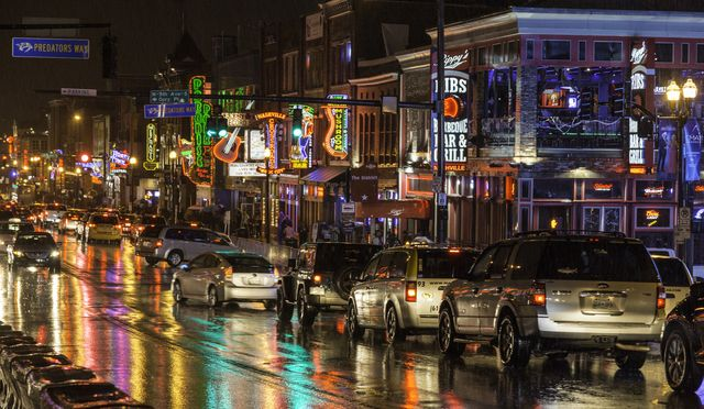 rain in the city   cars line up for nashville honky tonks in the rain