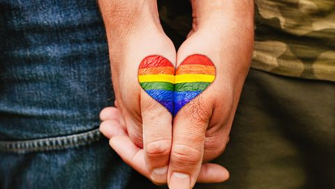 rainbow heart drawing on hands, lgbtq love symbol, gay couple hand in hand, lovers