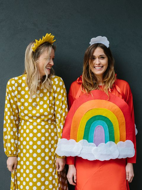 two women dressed as sunshine and rainbow costume