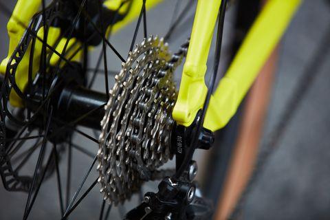 Bicycle wheel, Bicycle tire, Bicycle part, Bicycle, Yellow, Tire, Spoke, Vehicle, Mountain bike, Rim,