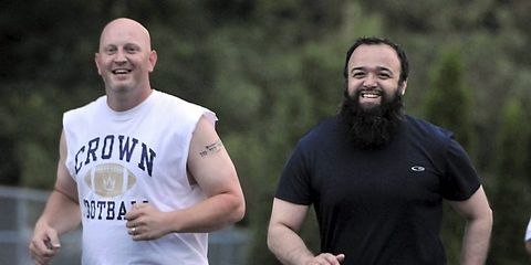 Smile, Sportswear, Beard, People in nature, Facial hair, Playing sports, Muscle, Player, Active shorts, Running,
