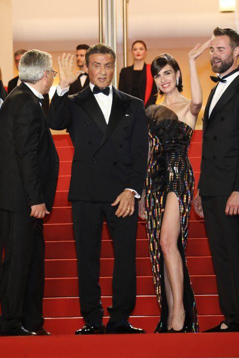 Red carpet, Carpet, Suit, Red, Formal wear, Event, Flooring, Premiere, Tuxedo, Dress,