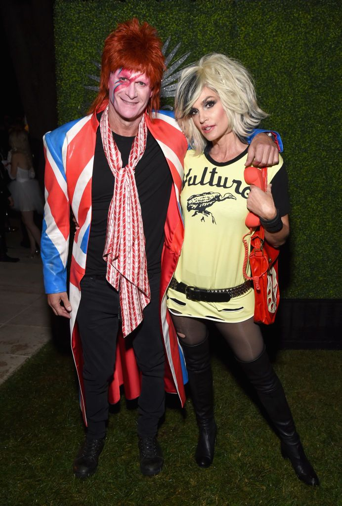 Rande Gerber and Cindy Crawford - David Bowie and Debbie Harry At the other Casamigos H-ween party, spouses Rande Gerber and Cindy Crawford dressed as iconic rockers David Bowie and Blondie's Debbie Harry, respectively.