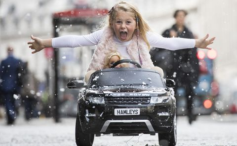 london, england   october 12  a girl drives a range rover evoque ride on electric car on regents street as hamleys announce its top ten toys for christmas at hamleys on october 12, 2017 in london, england  photo by tristan fewingsgetty images
