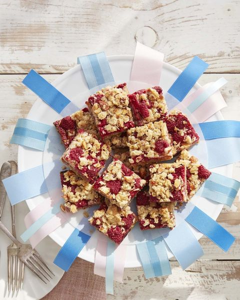 plate of raspberry bars adorned with ribbons