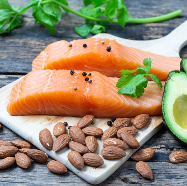 raw salmon with almond and avocado on a wooden table,healthy food concept