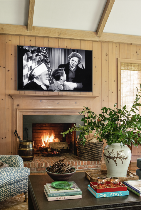fireplace with wood paneling around it