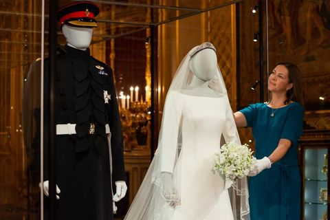 meghan markle s wedding dress on display inside the duke and duchess of sussex s wedding outfits exhibition meghan markle s wedding dress on