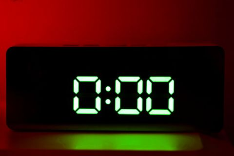 Real green led digital clock showing time 0:00