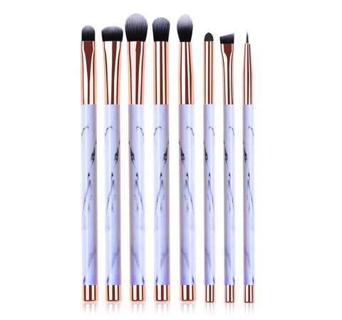Brush, Makeup brushes, Cosmetics, Product, Eye, Material property, Office supplies, Paint brush, Tool, Writing implement,
