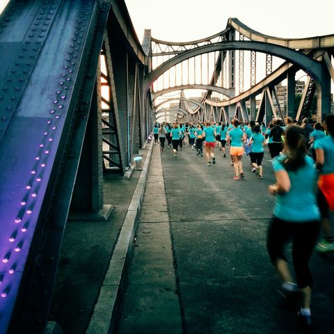 rear view of people running on bridge at prenzlauer berg