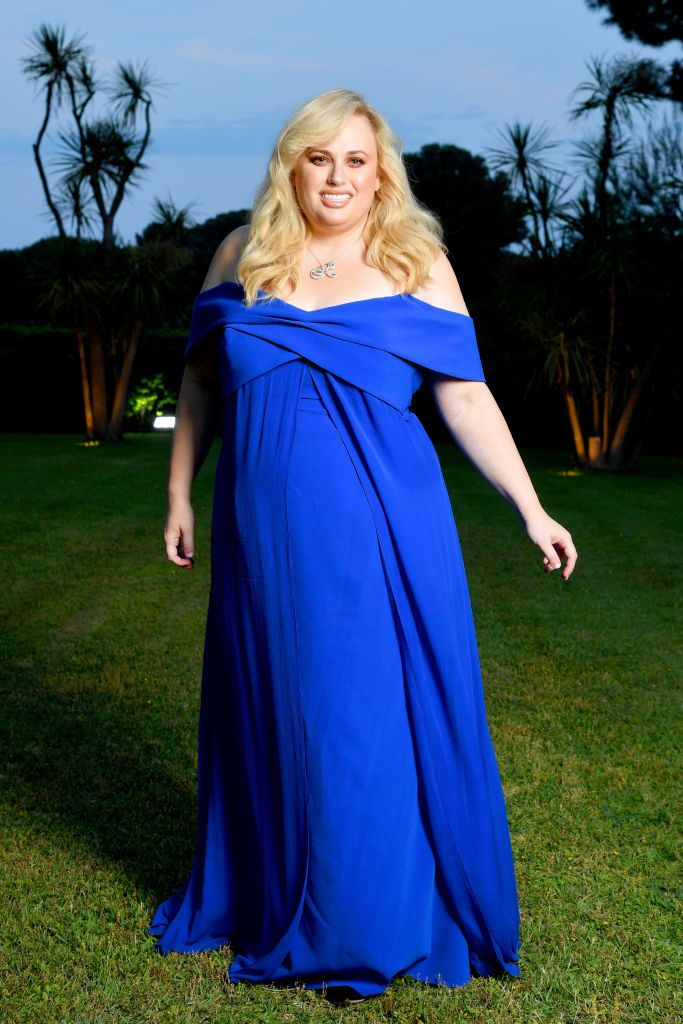 Rebel Wilson In a blue off-the-shoulder dress and Nigora Tabayer necklace.