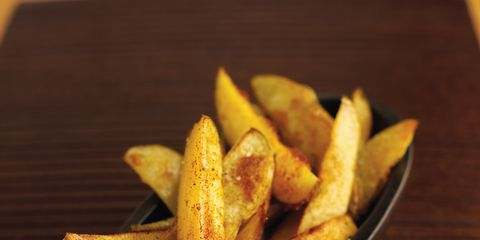 Food, Wood, Yellow, Fried food, Potato wedges, Deep frying, French fries, Side dish, Ingredient, Dish,