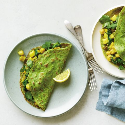 spinach curry crepes with apple, raisins, and chickpeas recipe   preventioncom