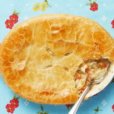 classic pot pie with spoon on blue linen