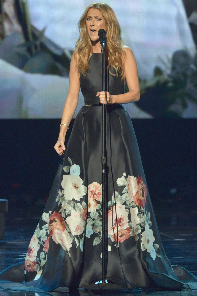 Dion performed at the American Music Awards, wearing a flattering  belted ball gown with floral detailing. Her beachy waves and minimal jewelry make the look less stuffy and more bohemian.