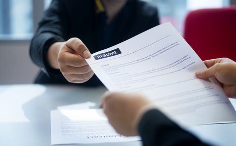 recruitment, job application, contract and business employment concept hand giving the resume to the recruiter to review the profile of the applicant