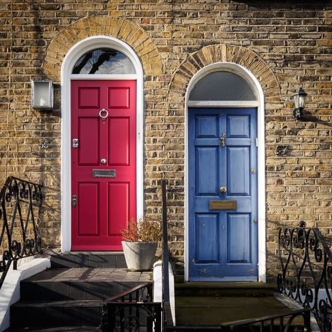 red and blue doors of a terrace georgian house