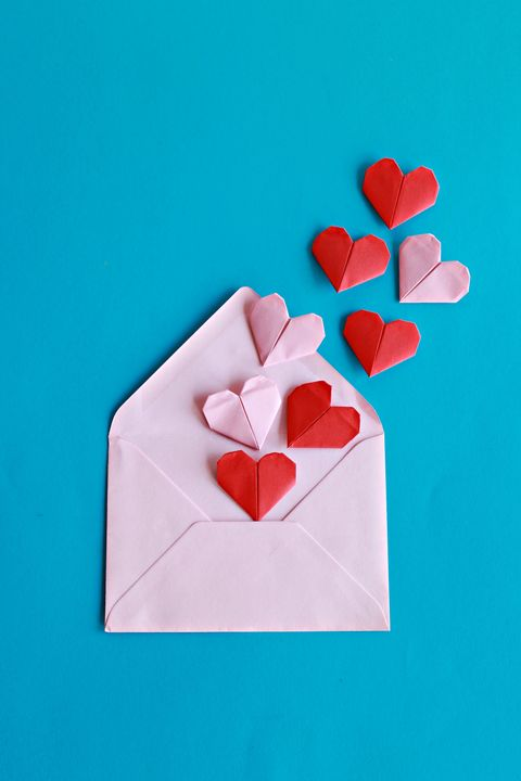 red and pink paper hearts on the pink envelope