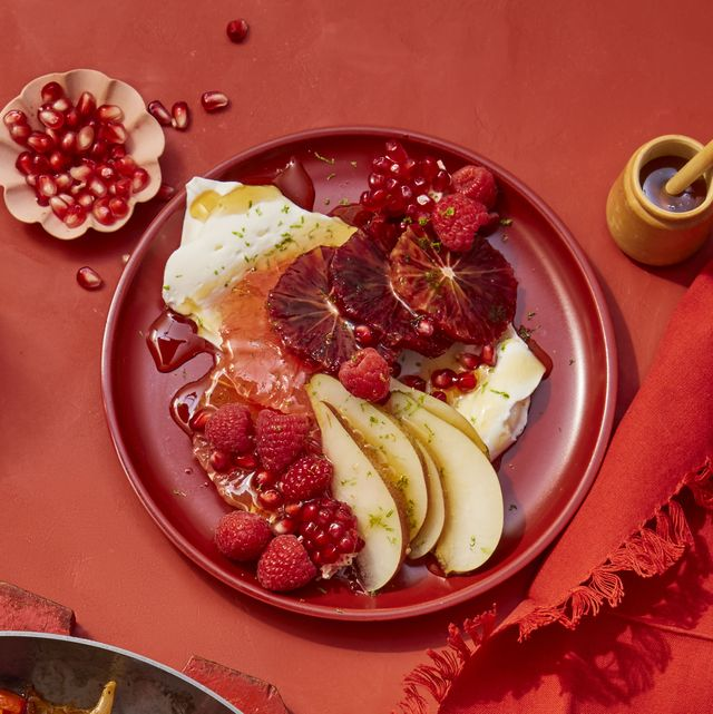 red citrus salad with berries, pears and pomegranates