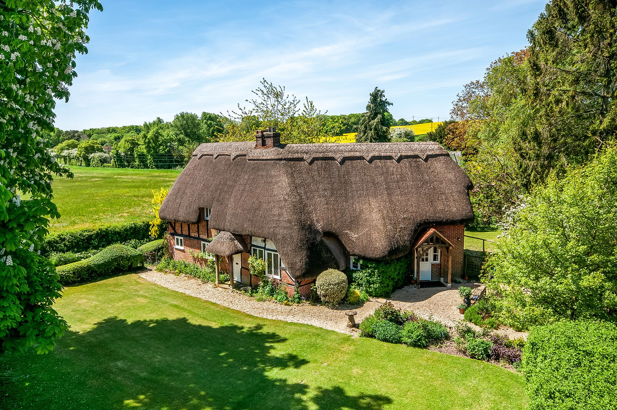 A picturesque thatched cottage with an outdoor swimming pool is for sale in Hampshire
